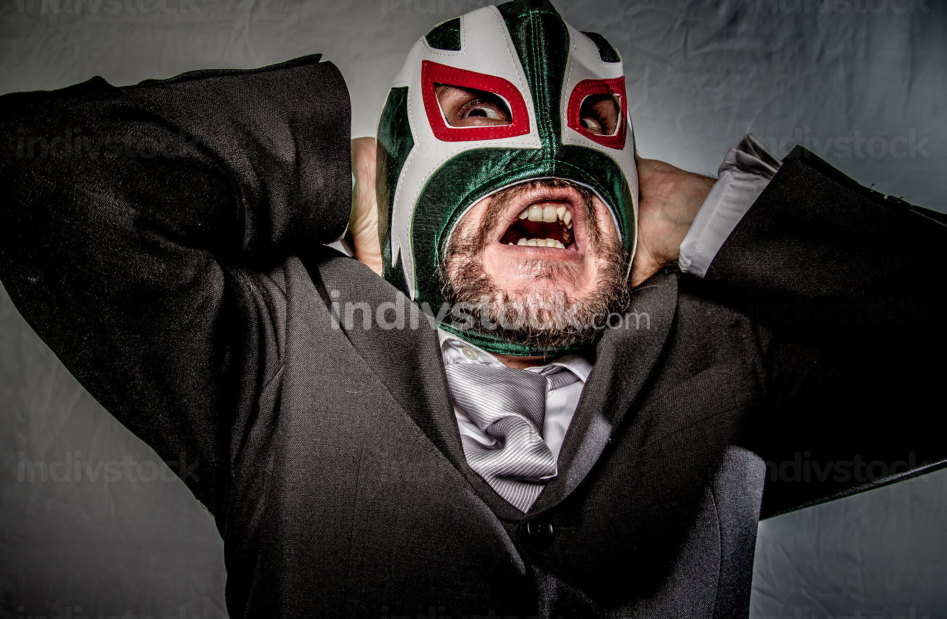 Problem, Angry businessman with mask of Mexican fighter, dressed
