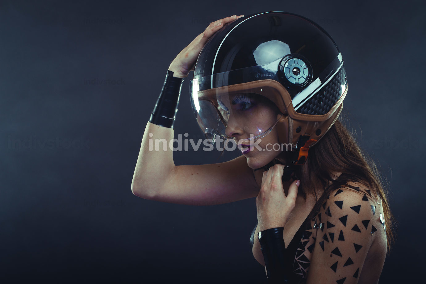 Protective, woman with motorcycle helmet, naked girl dressed wit