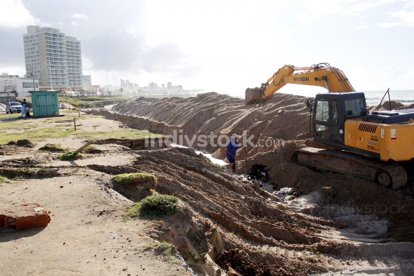 Salvador,Brazil, excavator works to contain the sea