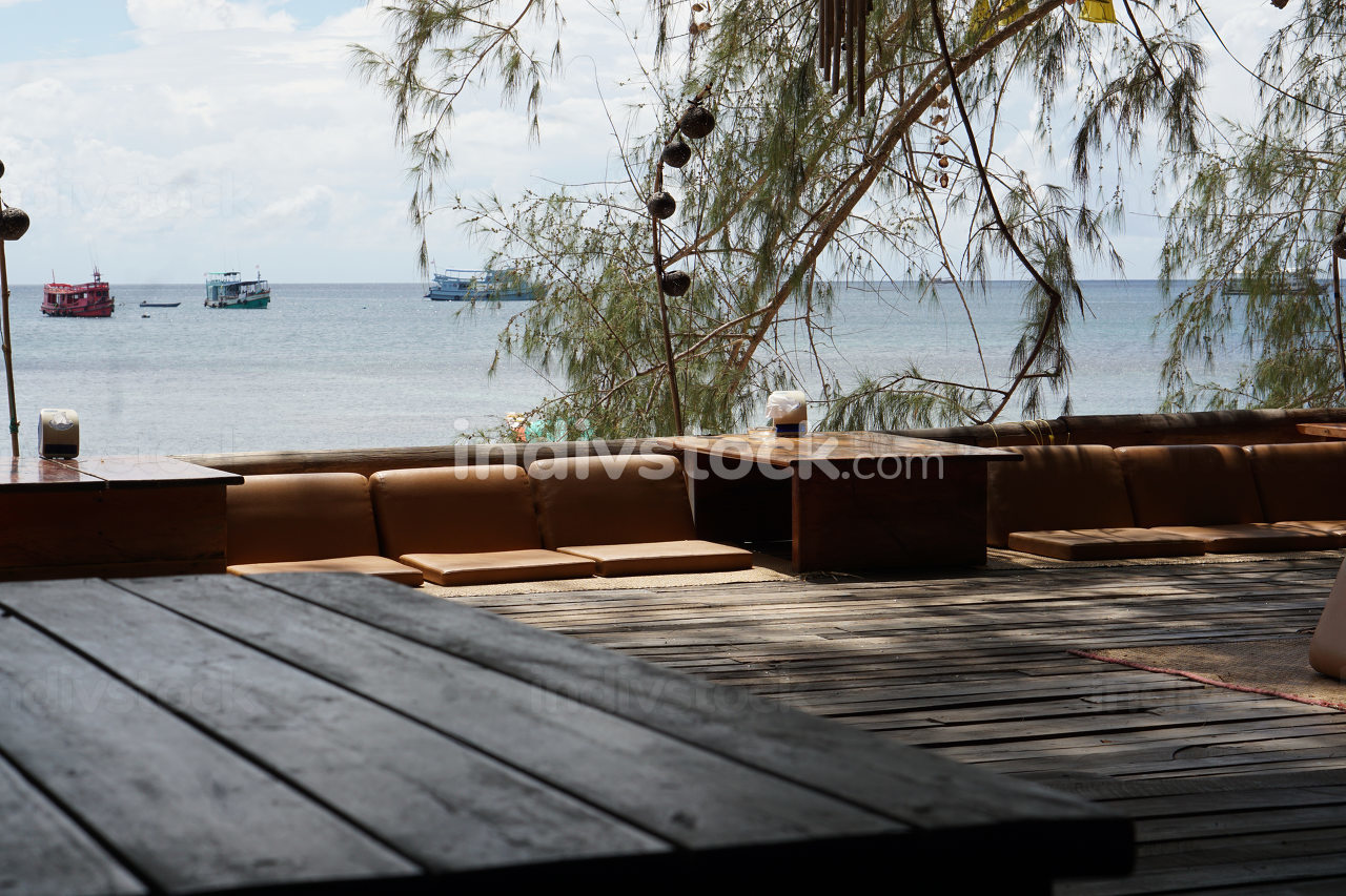 seats directly at the Beach, a beach view restaurant at the ocean in Koh Tao, Thailand