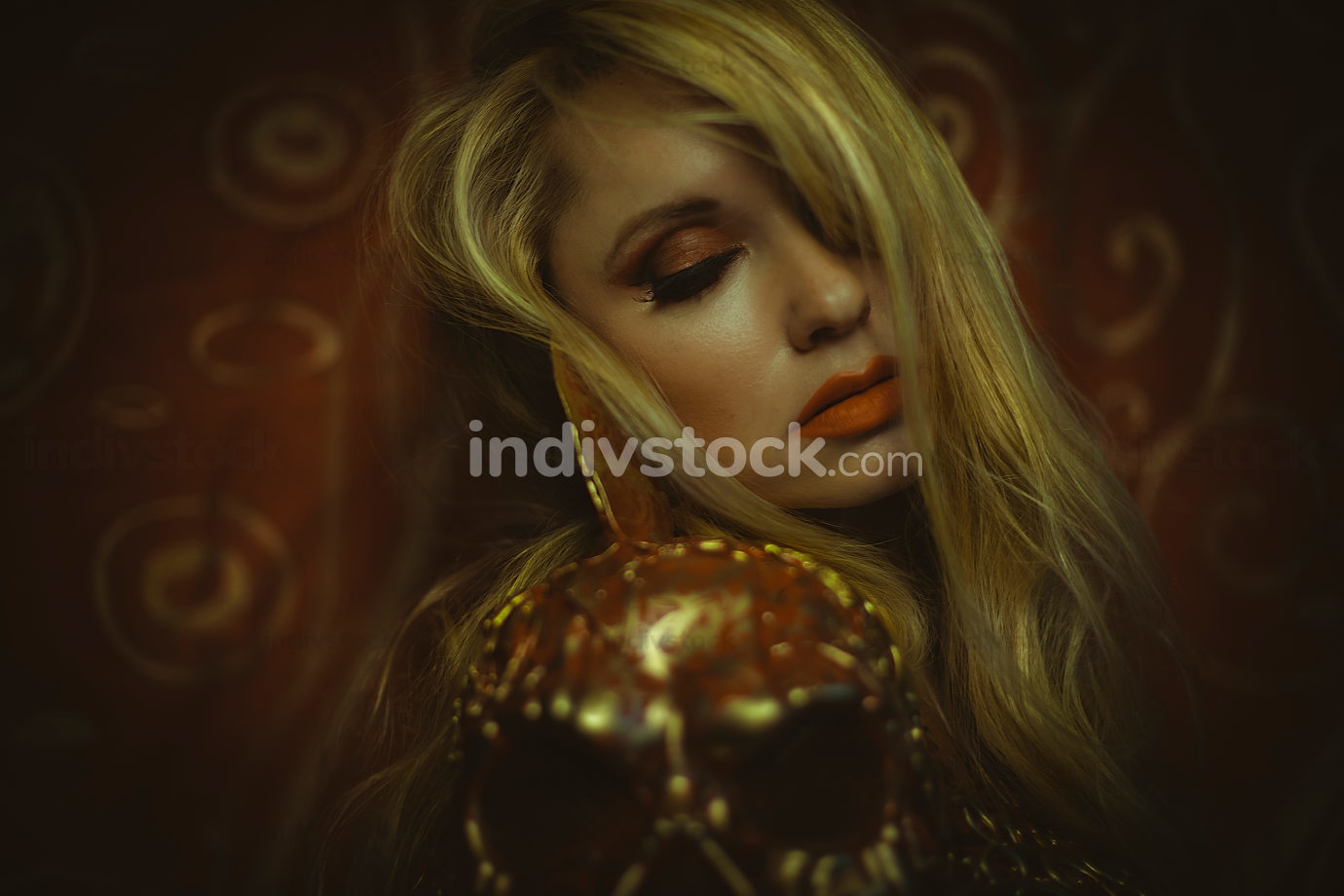 Sensual blonde with a melancholy red and gold armor, burlesque i