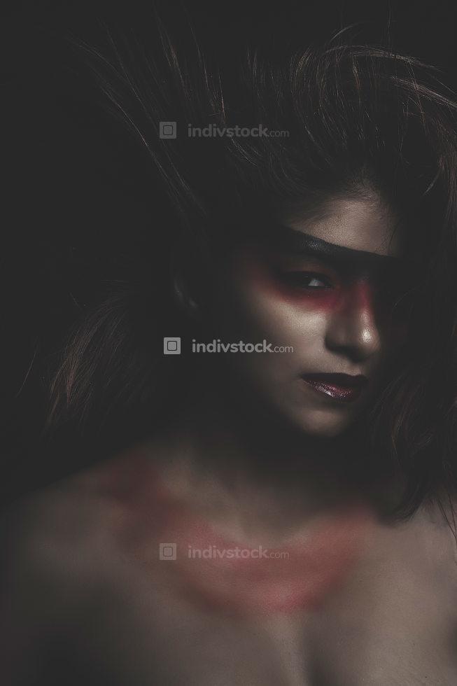 sensual latin woman, red make up in her eyes