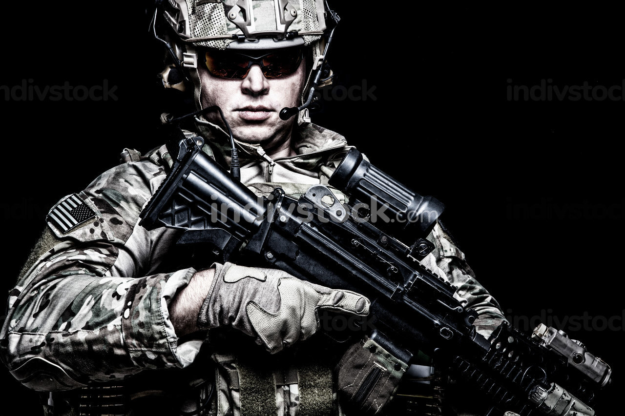 US army soldier, marine rider, special forces fighter in combat uniform, helmet and glasses, radio headset, armed assault rifle with night vision, thermal imagining, optical sight on black background