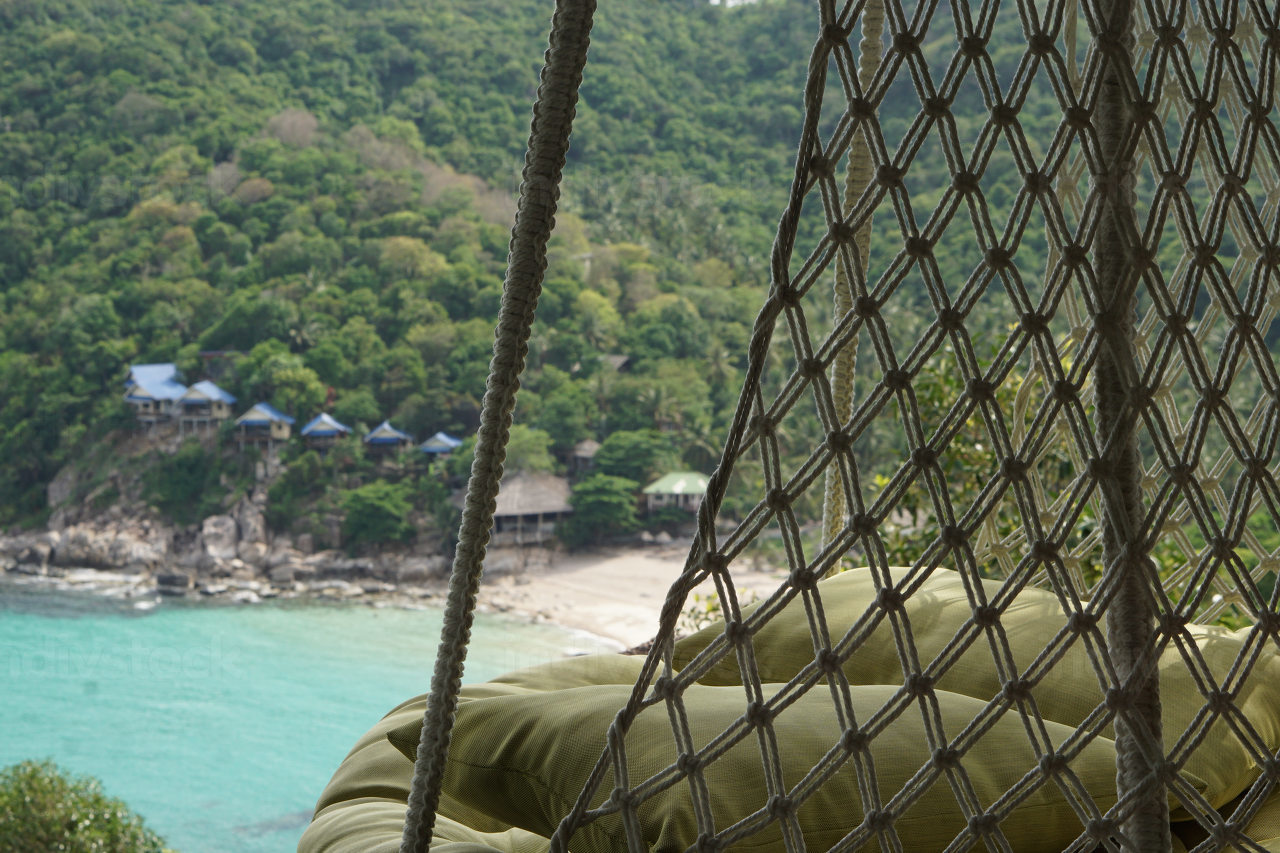 View with beanbag on the empty natural bay and the popular beach named Tanote Bay on the island named Koh Tao in Thailand, May 3, 2021