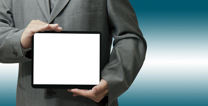 businessman hand holds and touch tablet computer