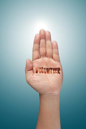 volunteer raising hand