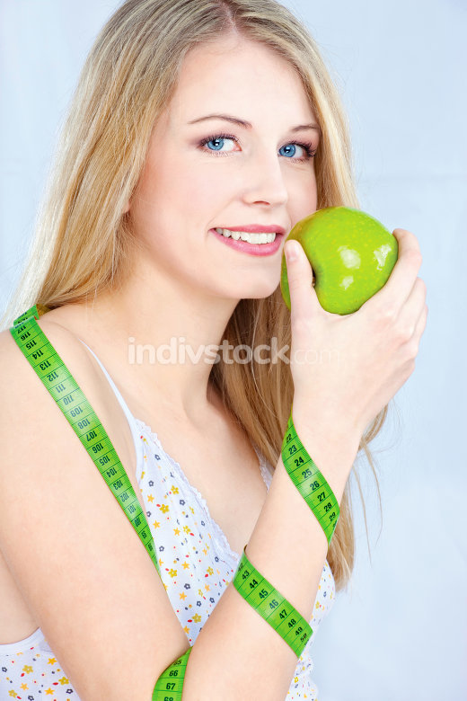 blond girl with apple and measuring tape