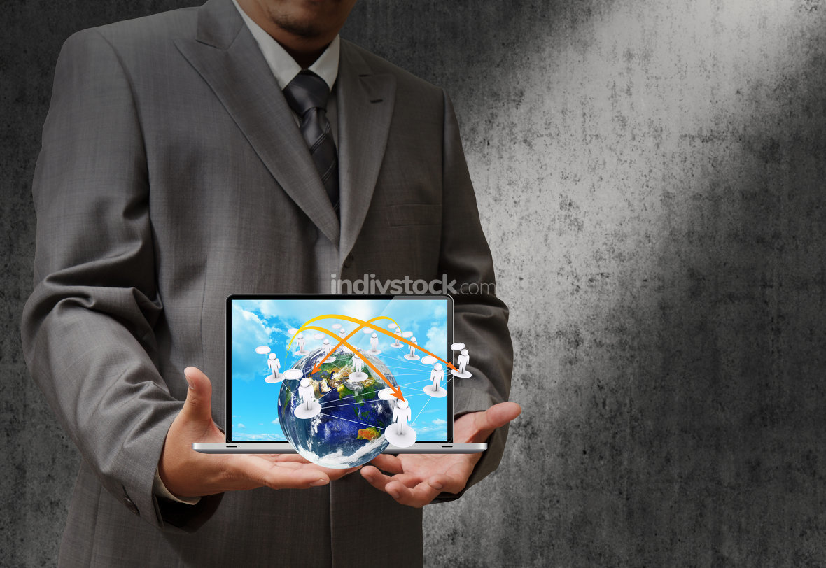 business hand holding a laptop computer and virtual social netwo