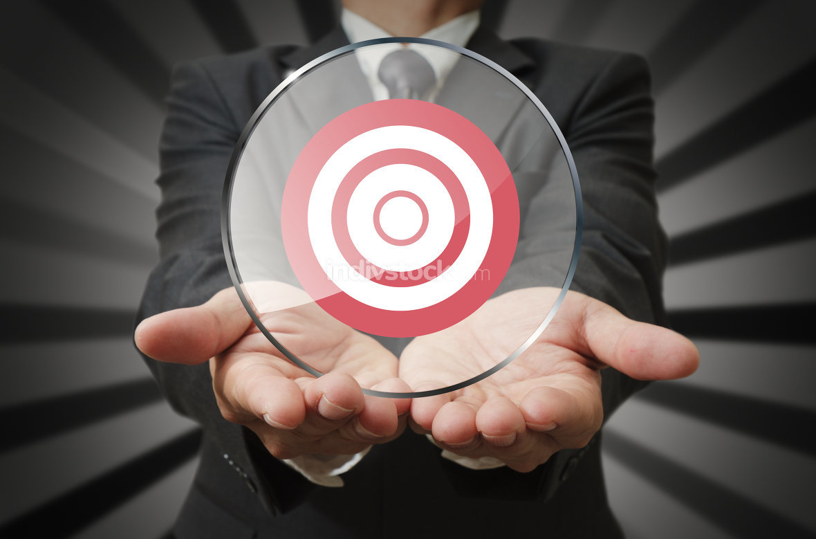 businessman holds target business in round panel glass as concep