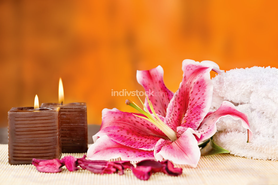 candles with towel and orchid
