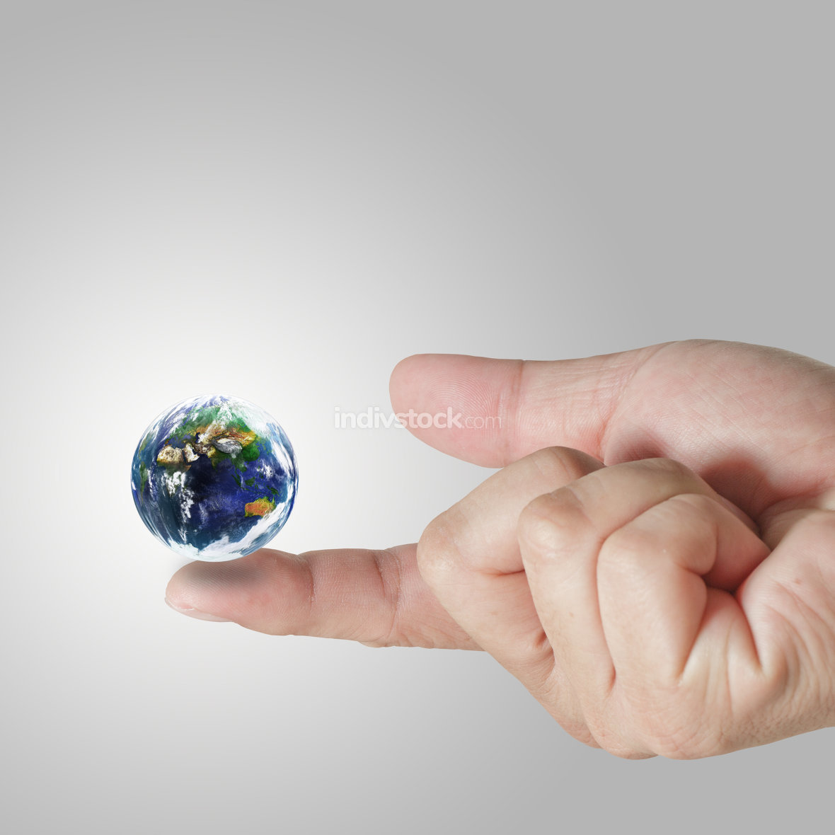 earth globe on his finger