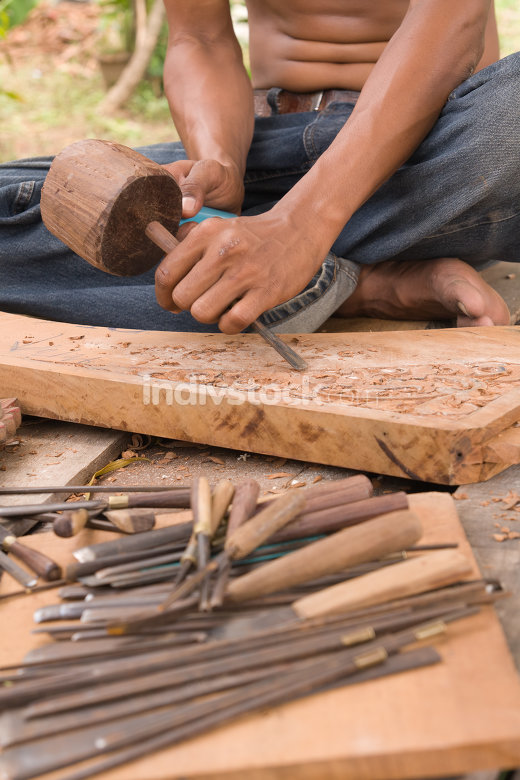 Traditional craftsman carving wood