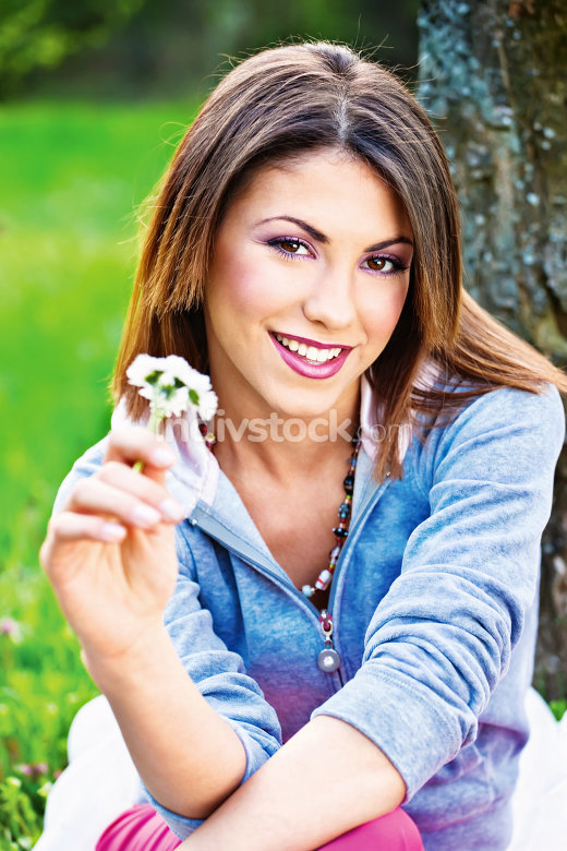 woman holding spring flowers